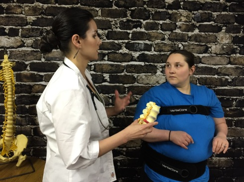 Chiropractor Explaining How a VerteCore Lift Can Help Overweight Patients