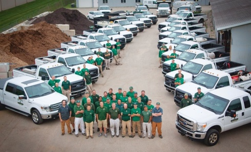 The Summit Landscape Management team with its truck fleet. Photo courtesy of Summit Landscape Management